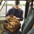 Filson Dryden Backpack 20152980 Whiskey on the front seat of a car
