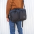 Topo Designs Global Briefcase Ballistic Black over shoulder