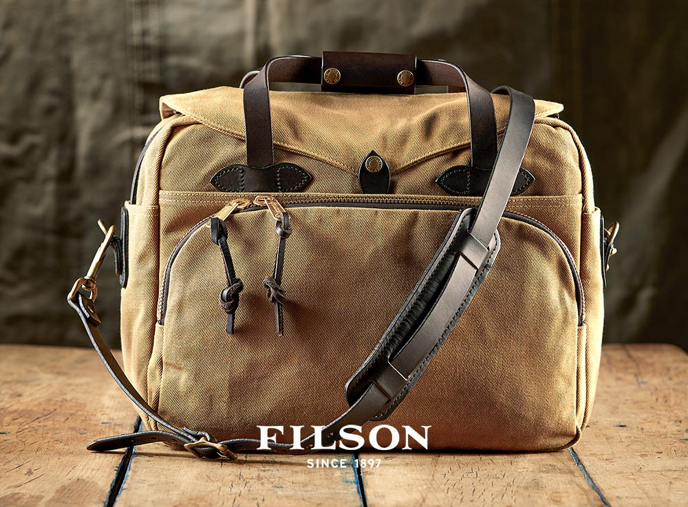 This is the perfect bag for carrying you laptop: Filson Padded Computer Bag