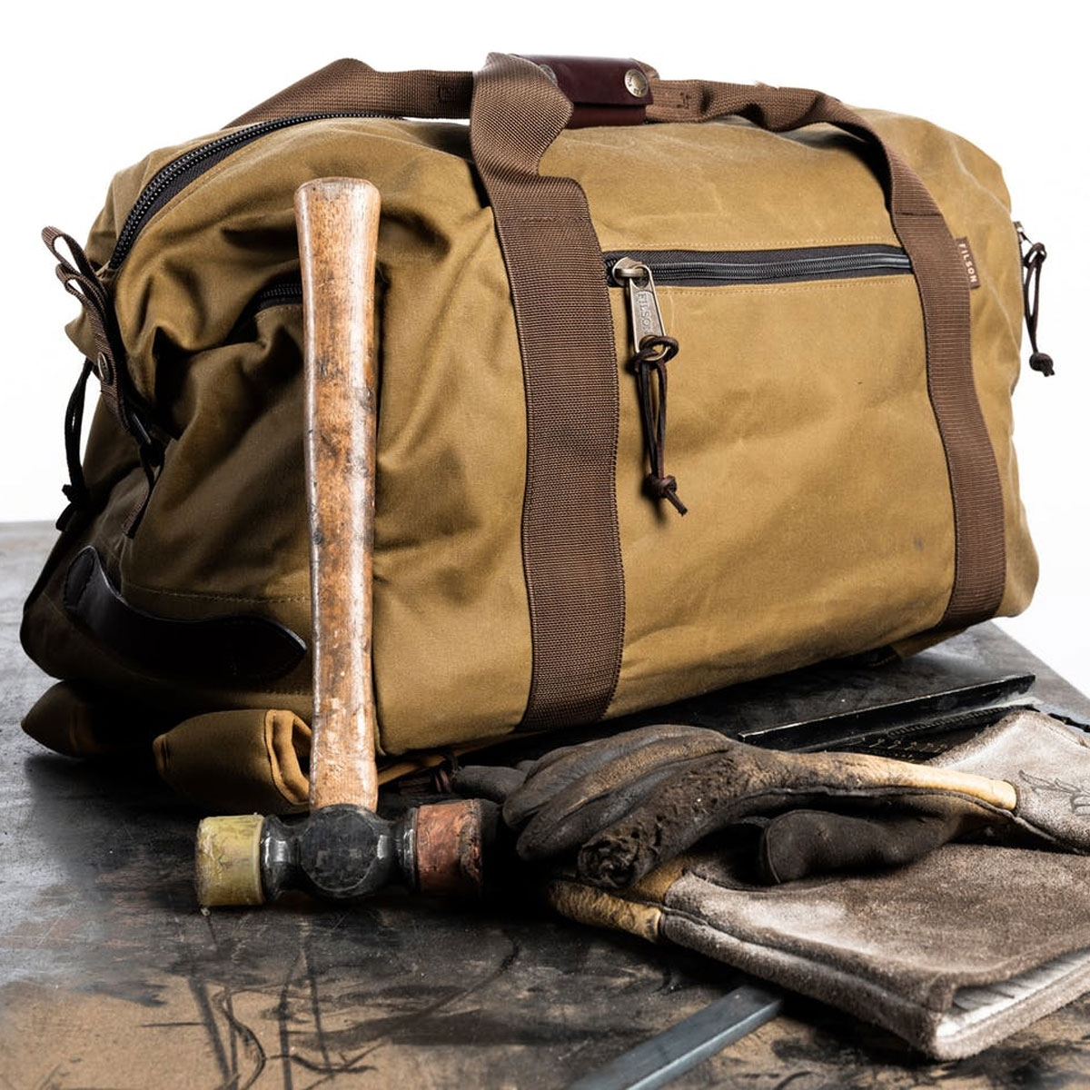 Filson Tin Cloth Duffle Pack Dark Tan/Brown, is overbuilt to go anywhere in any weather