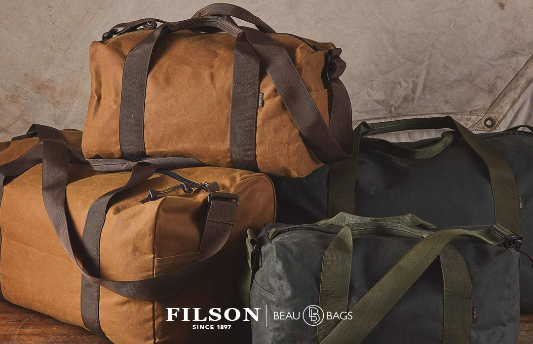 Filson Field Duffle Small DarkTan-Brown, heavy-duty duffle in water-repellent, wear-resistant 15-oz oil finish Tin Cloth fabric