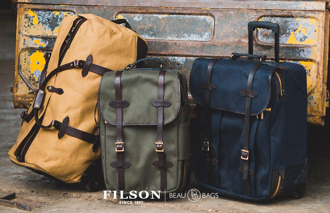 Filson Rolling Check-In Bag Navy, travel bag created for travel in style