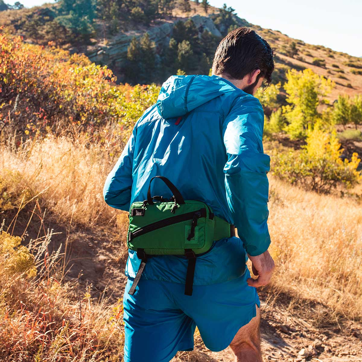 Topo Designs Mini Quick Pack Green, a well-built, secure bag for travel