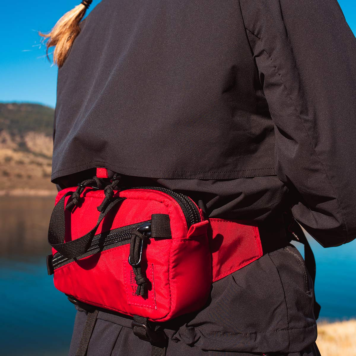 Topo Designs Mini Quick Pack Red, a well-built, secure bag for travel