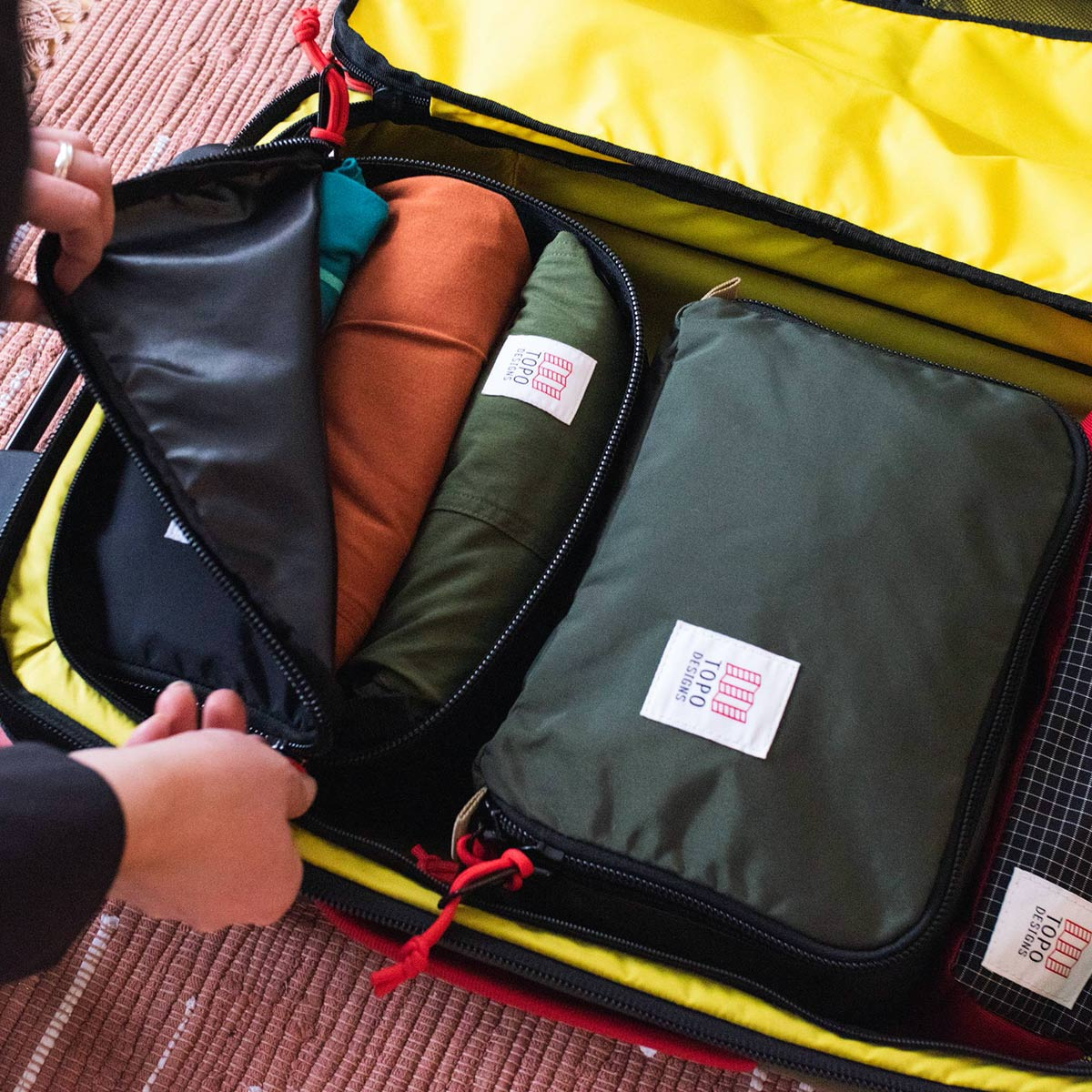 Topo Designs Pack Bag 10L Cube Black, a simple, durable and highly functional way to organize your luggage